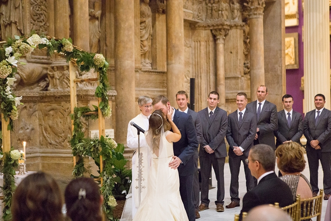 First kiss as Mr. and Mrs! We're loving this gorgeous museum wedding!