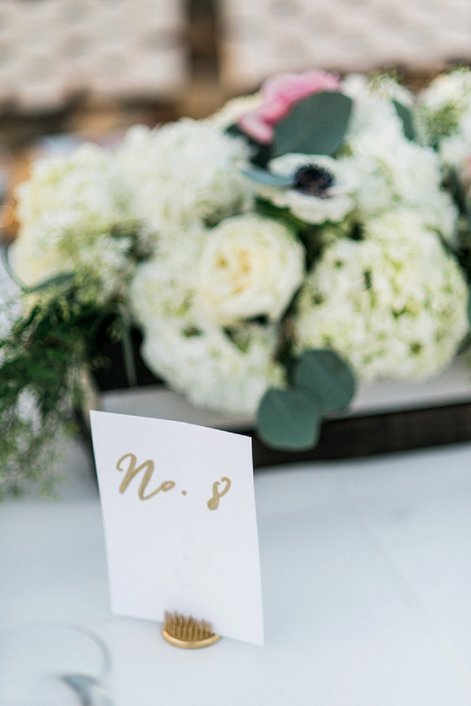 Loving all of the gold details in these DIY wedding! The handlettered gold table numbers are the perfect touch!