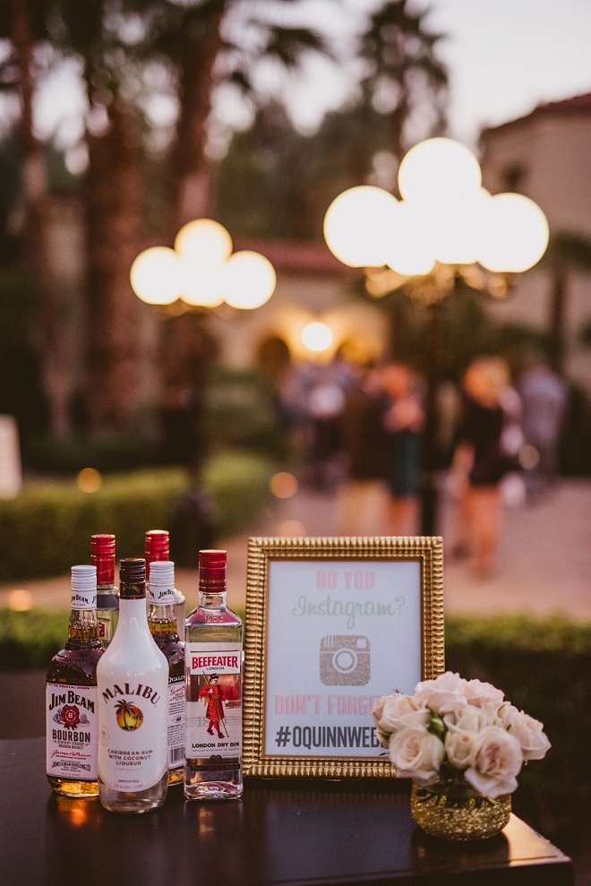 We're loving the customized signs for the bar at this gorgeous outdoor wedding reception!