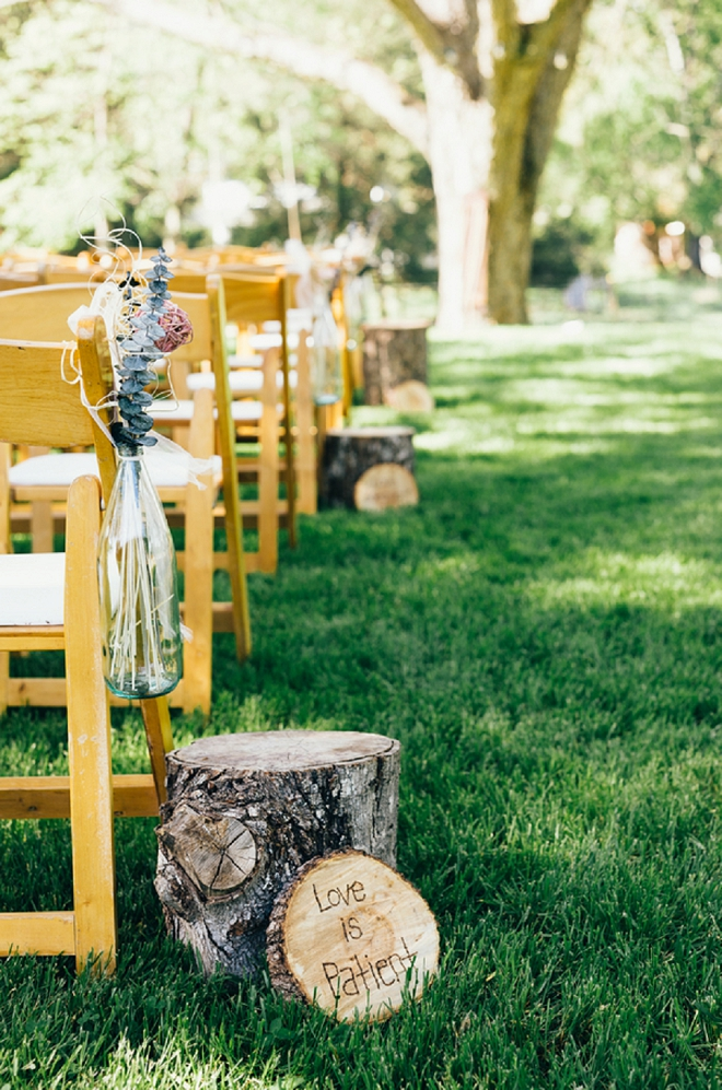 We LOVE the wooden bible versus this couple had down their ceremony aisle!