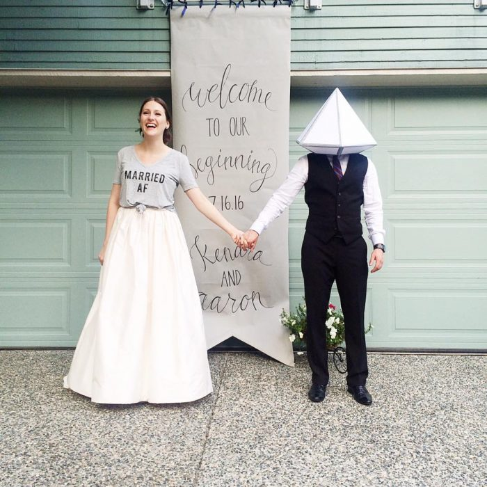 Such a funny and cute wedding photo - the bride and groom look so happy (well, the bride does! haha).