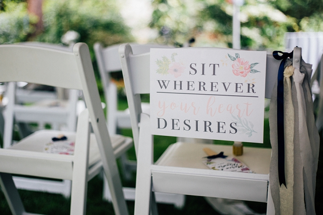 We love this couple's Sit Wherever ceremony sign!