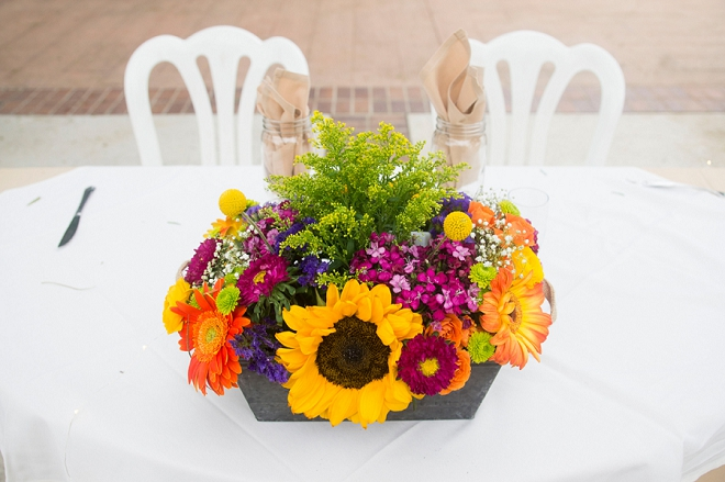 We love the rustic wooden centerpieces at this stunning fall wedding!