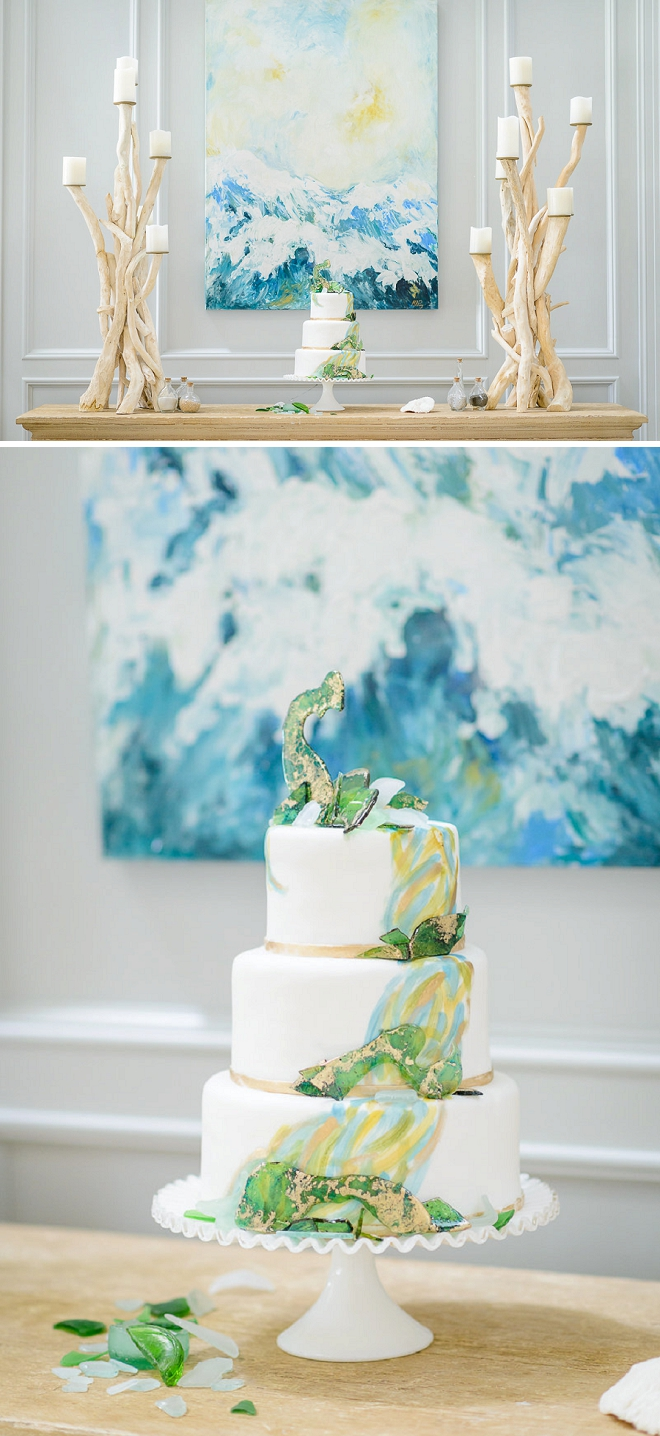 In LOVE with this stunning wedding cake with sea glass decor!