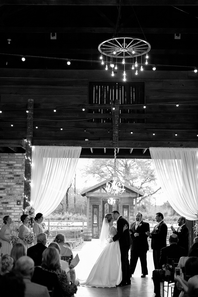 Stunning shot of this couple's first kiss as Mr. and Mrs!