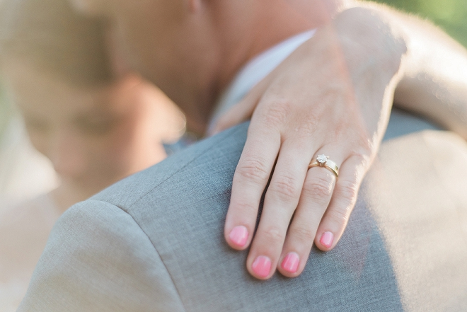 We love this super sweet shot of the brides pink wedding nails and ring!