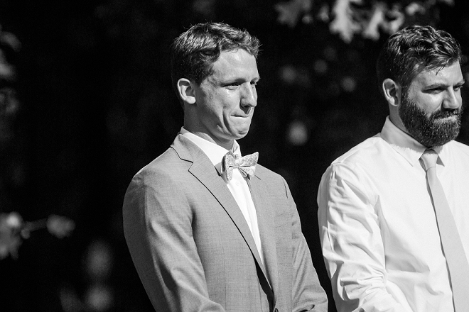 How sweet is this photo of the Groom seeing his Bride for the first time!