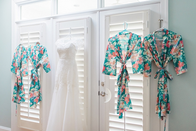 Such a darling shot of this Bride's wedding dress and Bridesmaid's robes!