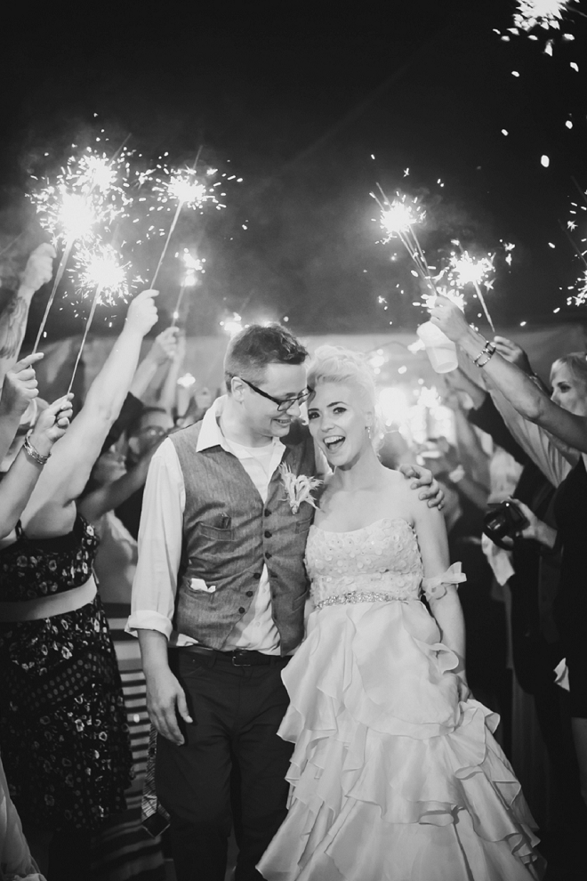The Mr. and Mrs. leaving their wedding through a sparkler exit!