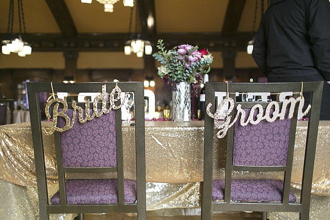 Darling Bride and Groom chair signs at their stunning sweetheart table!