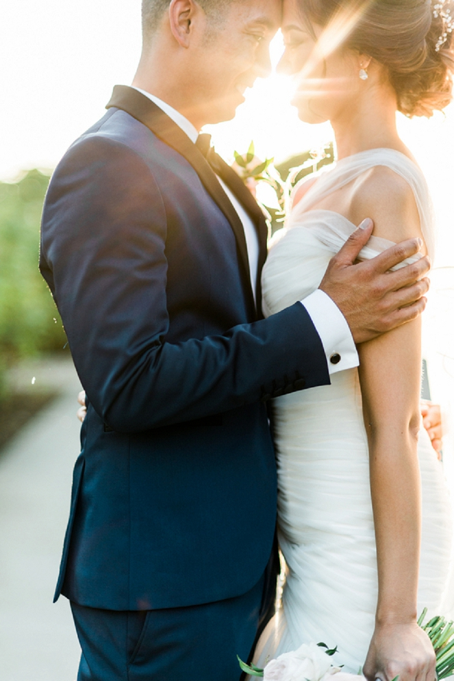 Stunning sunlit shot of the bride and groom by Shelly Anderson Photography