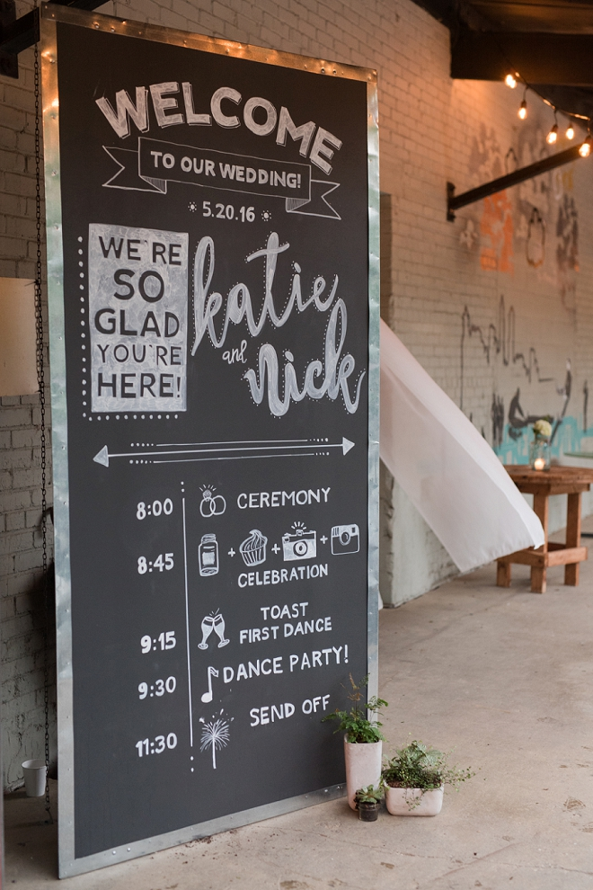 We love this hand lettered welcome chalkboard sign!