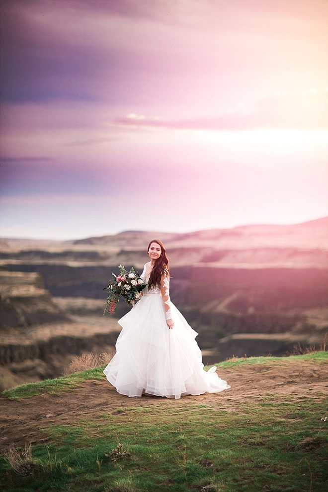 We are in LOVE with this Bride's long sleeved wedding dress at her styled anniversary shoot!