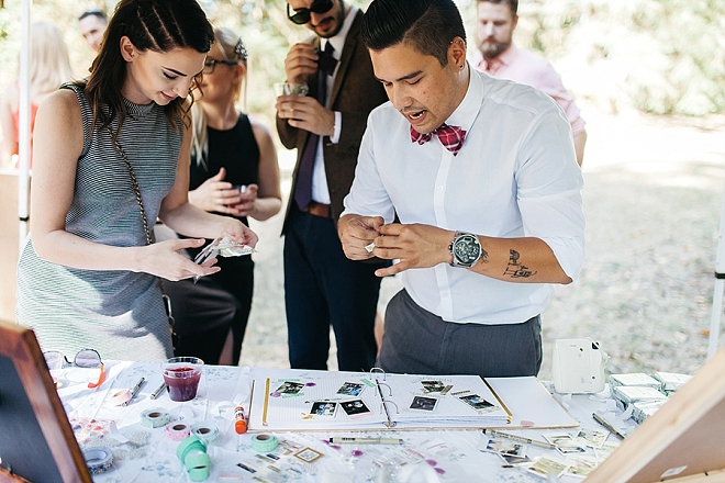 Loving this couples fun and interactive poloroid guest book!