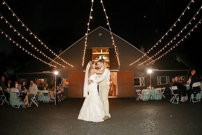 First dance as Mr. and Mrs. under the twinkle lit sky at this stunning barn wedding!