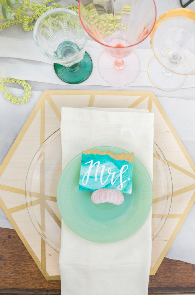 Loving these turquoise geode Mr. and Mrs. signs at this styled beach anniversary!