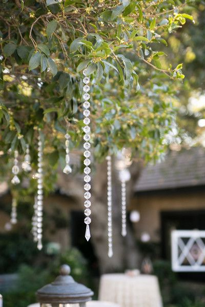 Romantic hanging beads from a tree - outdoor wedding ideas.