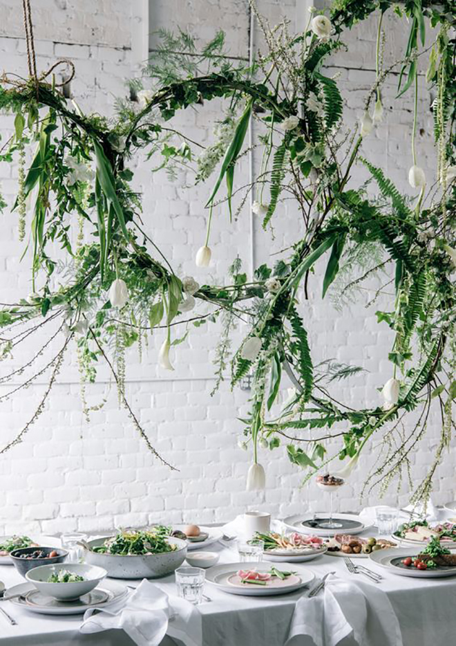 Floating wreaths add a magical touch of greenery.