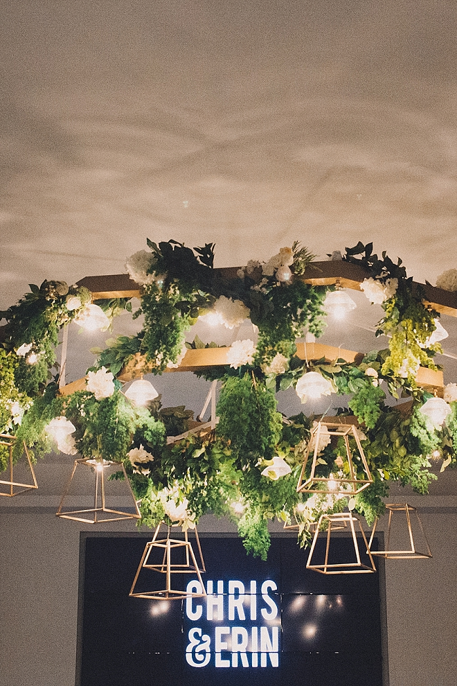 Check out this stunning signage and modern greenery chandelier!