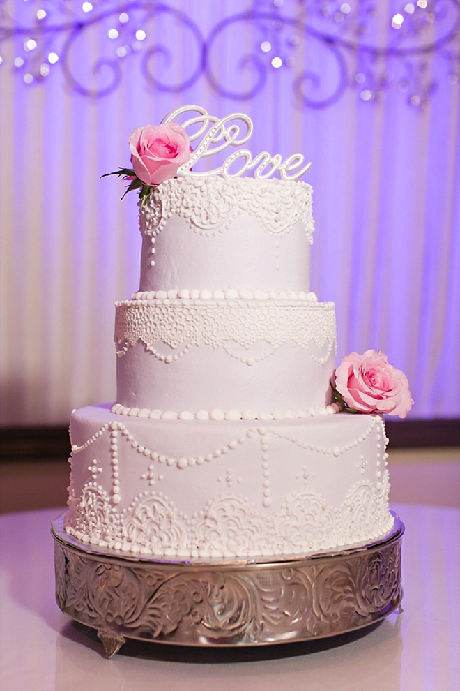 Check out this gorgeous white and pink rose wedding cake!