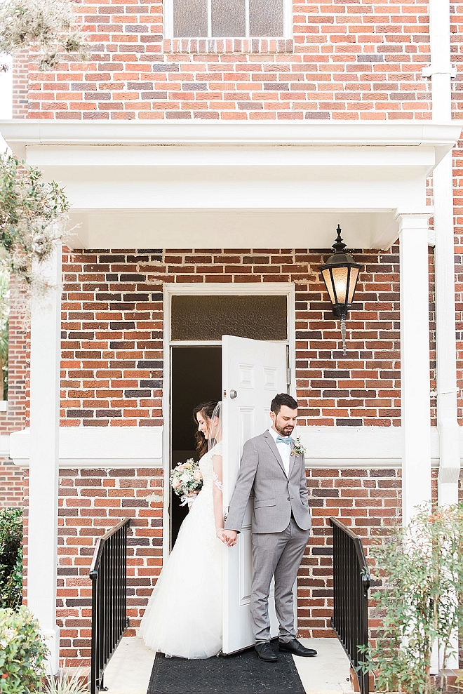 We're crushing on this darling couple's first touch before the ceremony!