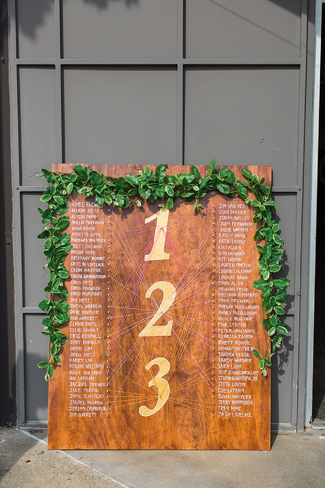 Check out this AMAZING handmade seating chart!! We're in LOVE!