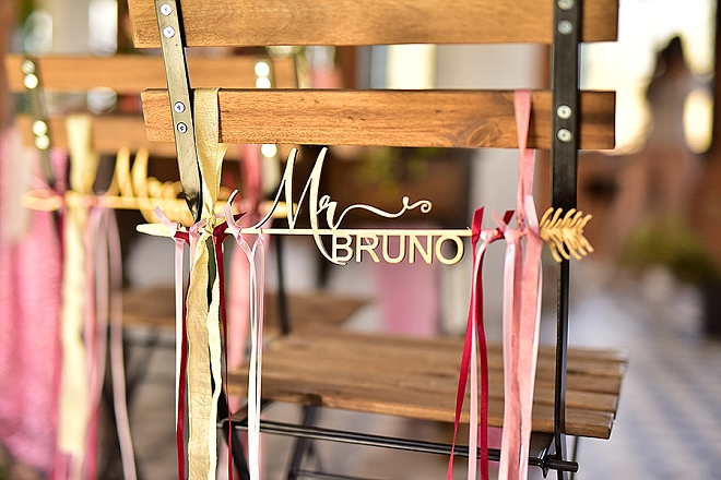 We're in LOVE with these gorgeous custom wooden chair hangers for the bride and groom!