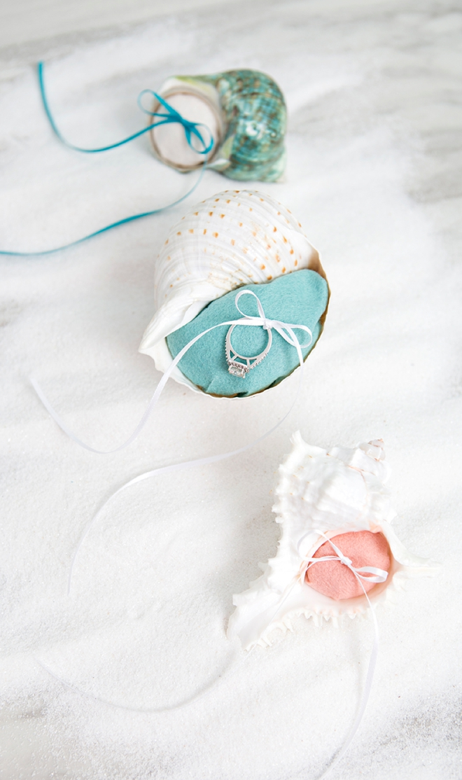 These little DIY felt seashell ring bearer pillows are perfect for your beach wedding!