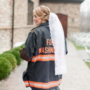 We're swooning over this super sweet snap of this Bride in her Hubby's fireman's jacket!