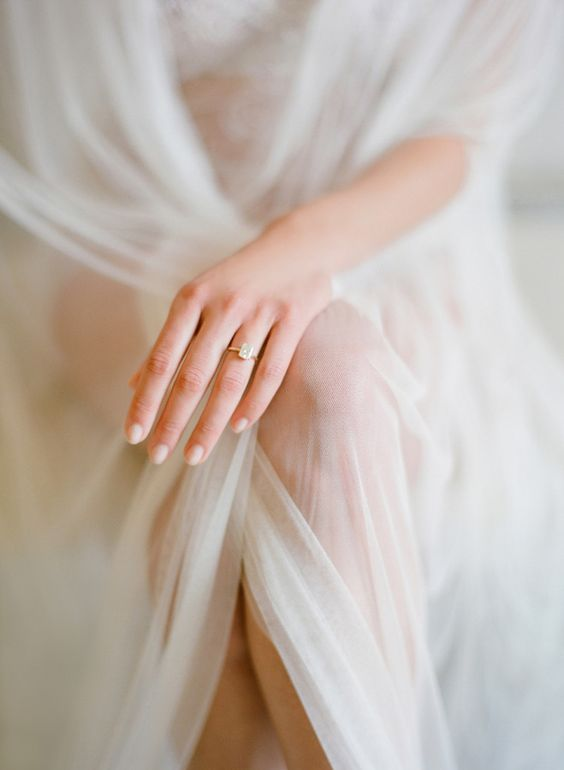 Gorgeous boudoir shot of a bride in her veil and ring by Jose Villa