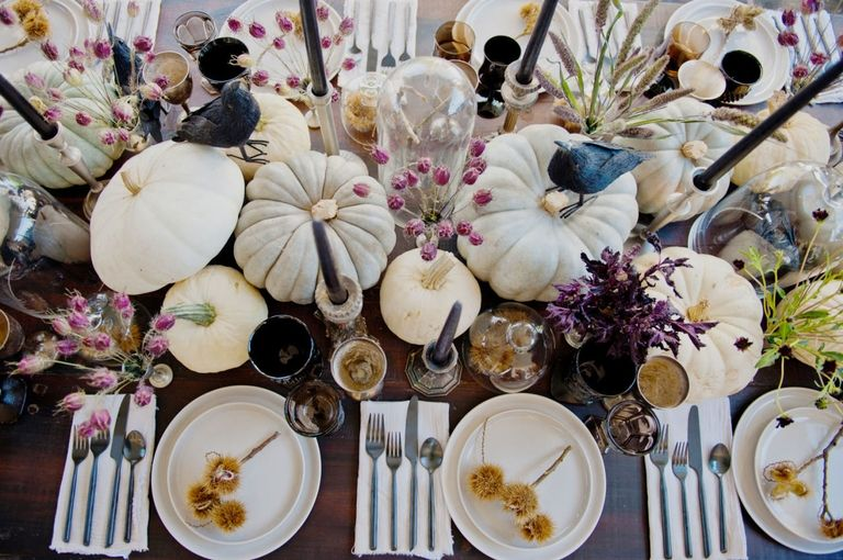 White pumpkin table setting. Beautiful centrepieces.