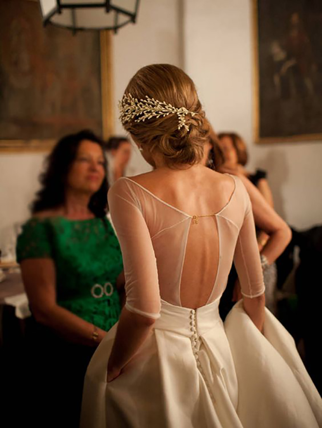 A sprig of winter berries take your wedding hair to the next level.