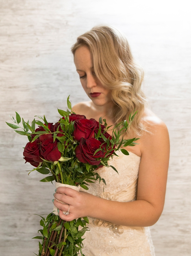 Stunning bride with her Black Magic Rose wedding bouquet she made from FiftyFlowers.com!