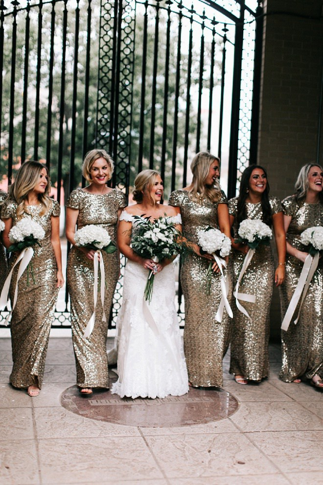We LOVE these super fun gold and glittery bridesmaid's dresses!