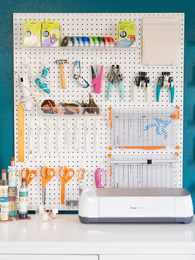 Wow, this peg board tool wall and Cricut station is amazing!