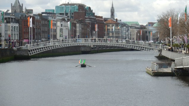 The Ha'Penny Bridge being iconic with a lone rower on Easter Monday