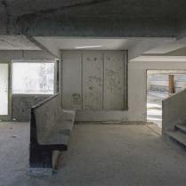 Remains of some concrete furniture inside a gutted Grand Hotel.