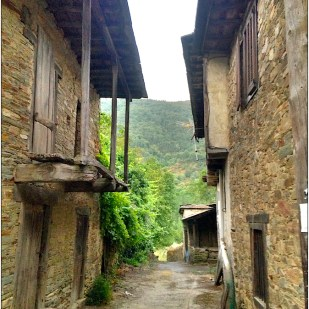 narrow road through ancient stone village
