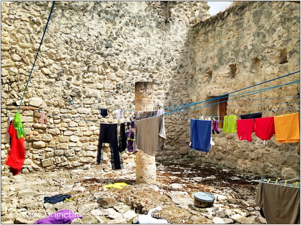 Clothes on clothesline in stone courtyard