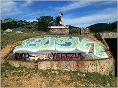 Man on bunker with graffiti