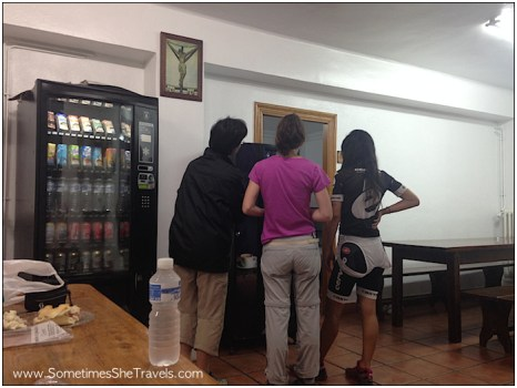 Olalla and some other pilgrims attempting to figure out the coffee vending machine in the albergue dining hall.