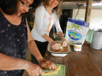 Mixing mbeju dough by hand, adding the cheese