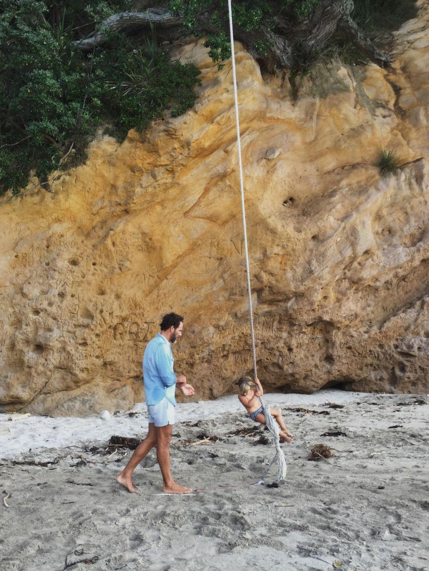 Michael pushing marlow on rope swing