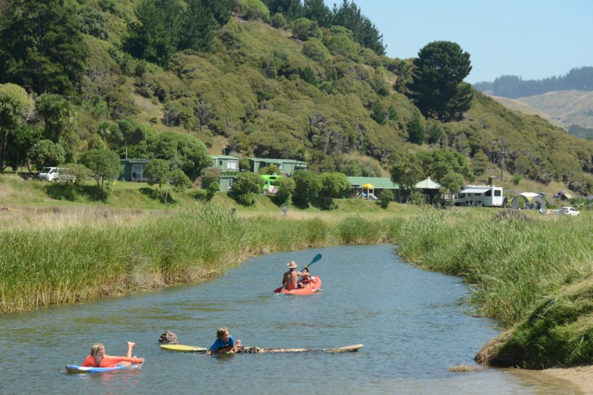 playing in the river at Waipatiki