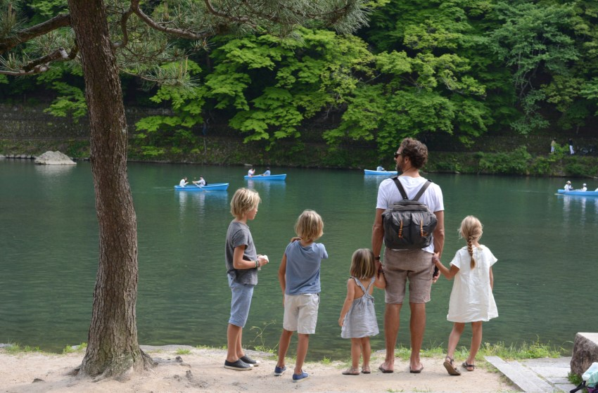 watching boats in river in Kyoto