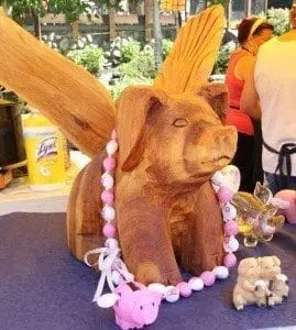 Wooden sculpture of a pig with wings at the Bulleit Bourbon Canadian National BBQ Championships