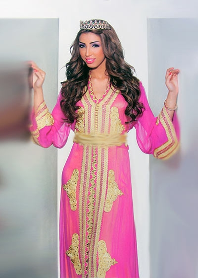 Moroccan Pink Caftan with gold threadwork worn by moroccan singer Dounia Batma