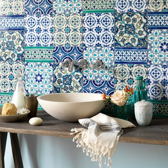 Bathroom with Moroccan-inspired ceramic tiles in various shades of blue. Photo credit: House to Home