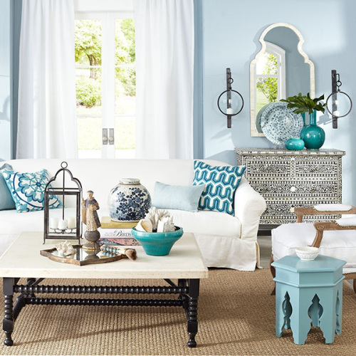Moroccan Style Living Room with a Pop of Blue, via Wisteria