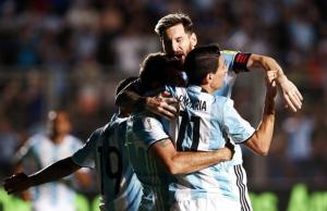 Football Soccer - Argentina v Colombia - 2018 World Cup Qualifiers - Del Bicentenario Stadium, San Juan, Argentina - 15/11/16. Argentina's Lucas Pratto (C) is embraced by teammates Lionel Messi and Angel Di Maria after he scored his team's second goal. REUTERS/Enrique Marcarian